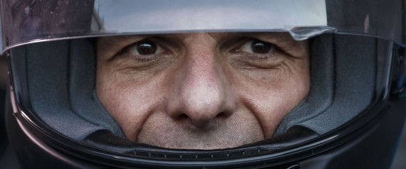 FILE - In this photo taken on Wednesday, July 1, 2015 Greece's Finance Minister Yanis Varoufakis puts on his motorbike helmet as he leaves his office in Athens. Varoufakis resigned on Monday, July 6, 2015 saying he was told shortly after the Greek referendum result that the some eurozone finance ministers and Greece's other creditors would prefer he not attend the ministers' meetings.(AP Photo/Daniel Ochoa de Olza, File)